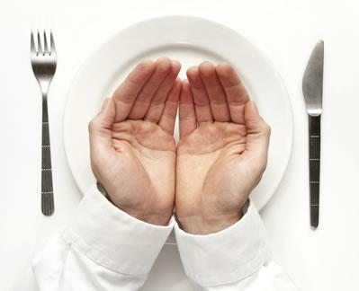 Empty hands over plate